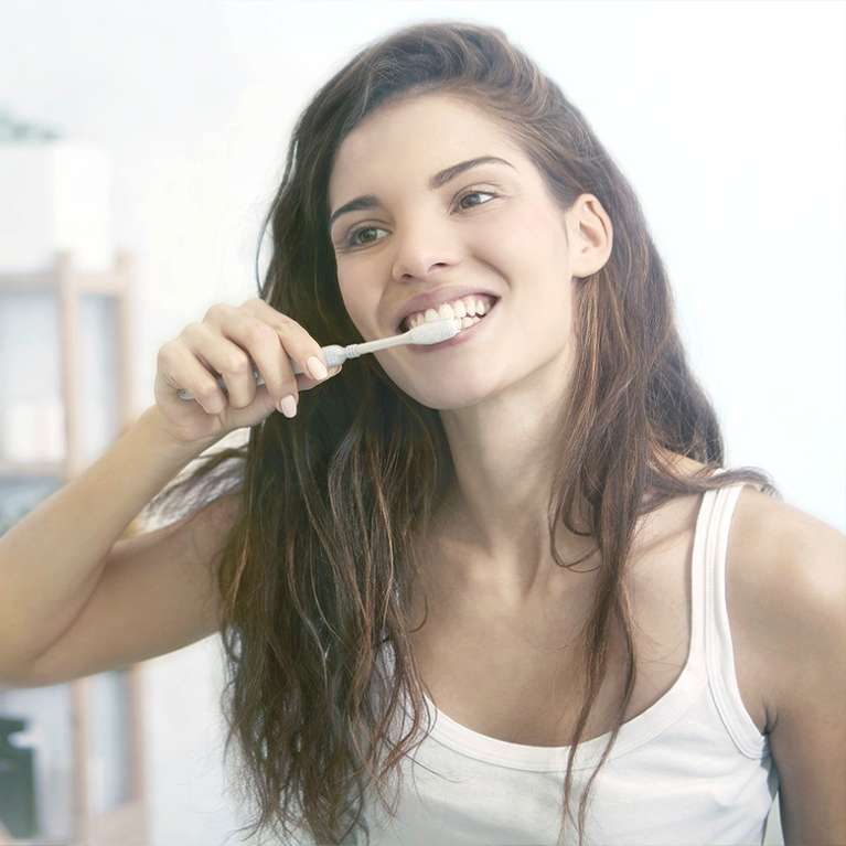 Woman showing healthy gums